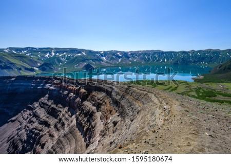 Panoramic view of the city Petropavlovsk-Kamchatsky and volcanoes: Koryaksky Volcano, Avacha Volcano, Kozelsky Volcano. Russian Far East, Kamchatka Peninsula. #1595180674