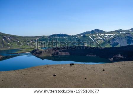 Panoramic view of the city Petropavlovsk-Kamchatsky and volcanoes: Koryaksky Volcano, Avacha Volcano, Kozelsky Volcano. Russian Far East, Kamchatka Peninsula. #1595180677