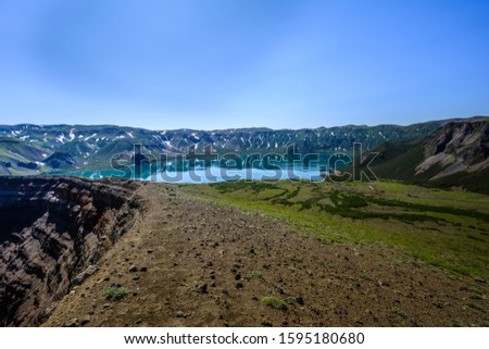 Panoramic view of the city Petropavlovsk-Kamchatsky and volcanoes: Koryaksky Volcano, Avacha Volcano, Kozelsky Volcano. Russian Far East, Kamchatka Peninsula. #1595180680