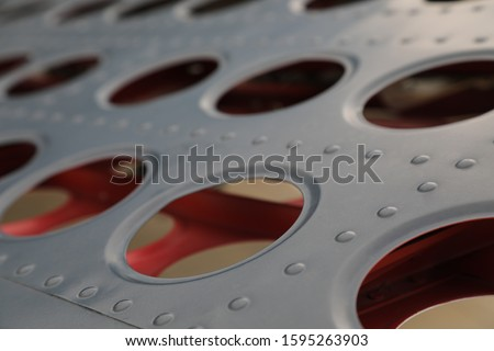 A Shallow Depth of field close up of an aircraft contol surface Royalty-Free Stock Photo #1595263903