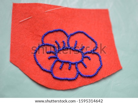 Process of making a flower beaded brooch - contour on felt embroided with blue beads - beginning master class #1595314642