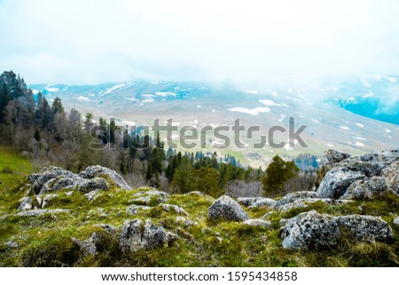 hillside with stones in the fog #1595434858