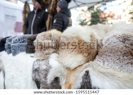 Fur hats and other animals furs on exhibition at a peasants fair in Bucharest, Romania. #1595515447