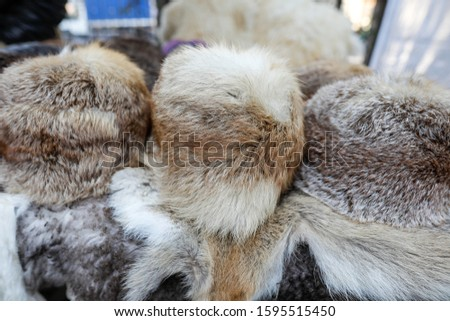 Fur hats and other animals furs on exhibition at a peasants fair in Bucharest, Romania. #1595515450