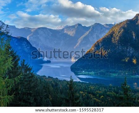 Idyllic morning colorful autumn alpine view. Peaceful mountain lake with reflections on water surface. Hallstatter lake, Upper Austria. #1595528317