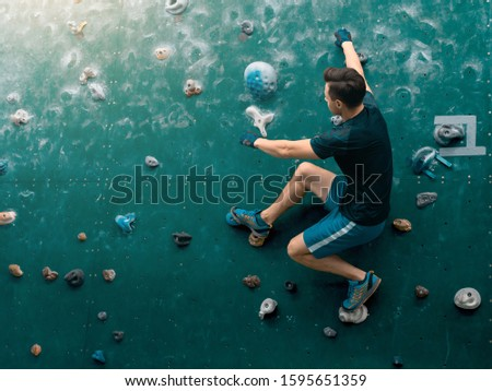 Climbing icon. Man climbing on wall. Climber in boulder gym. Climbing background. #1595651359