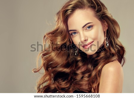 Beautiful girl and long wavy hair .  Brunette with curly hairstyle #1595668108
