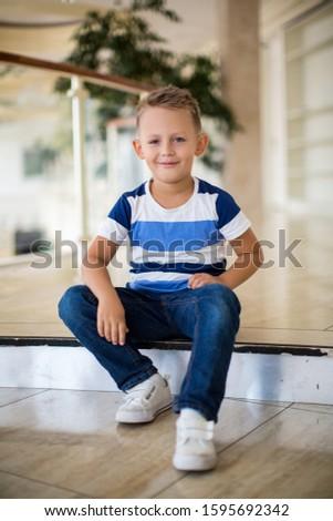 boy sits on a step #1595692342