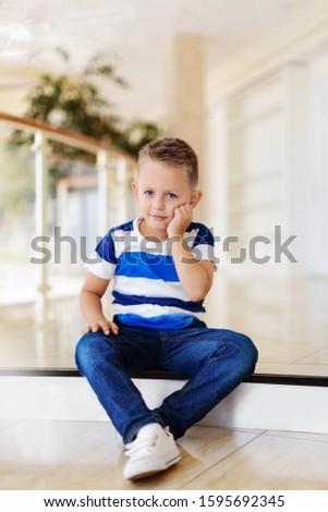 boy sits on a step #1595692345