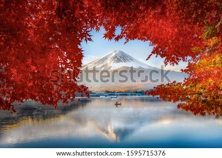 Fuji Mountain Reflection and  Fisherman Boat with Red Maple Leaves Frame in Autumn at Kawaguchiko Lake, Japan #1595715376