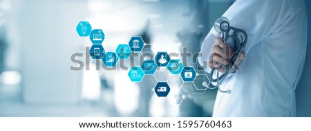 Healthcare business and Medical examination, Doctor with stethoscope and white icon medical with analyzing data and growth chart on hospital background, Medical business and technology concept.