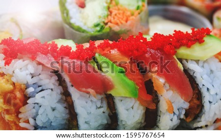 Japanese sashimi sushi rolls with salmon roe in close up picture. Donburi in asian style food. Shrimp with rice in close-up image. Plate of shrimps. Fresh and delicious maki and nigiri sushi.