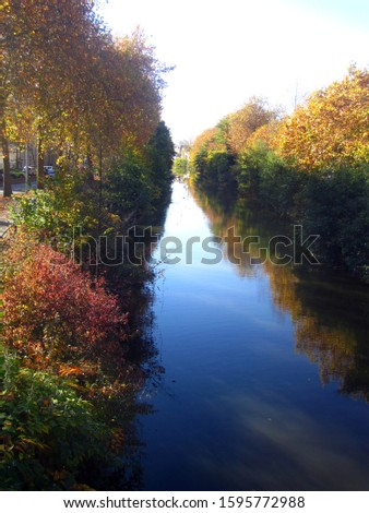 creek on the outskirts of the city                 #1595772988