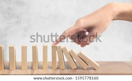 Hand and the Domino effect stopped by unique #1595778160