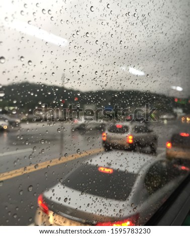 Rainy day scenery in the bus #1595783230