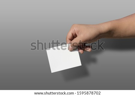 concept vote election Election of members of parliament, president, chief, executive. a ballot paper in hand isolated with clipping path on background #1595878702