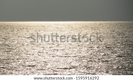 Sparkling sunlight mirrored by the ocean #1595916292
