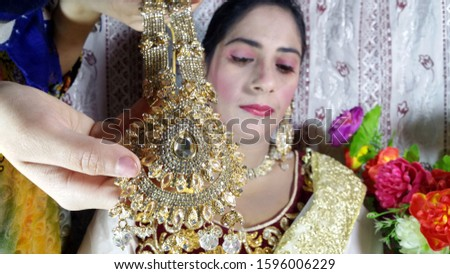 Beautiful image of a bride with gold and jewelry stock image. A wedding photography of a bride jewelry. bridal jewelry pics. bridal makeup. bridal makeup for marry.bride makeup. Bride getting ready f