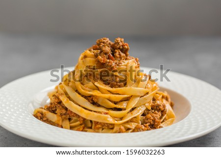 Tagliatelle al ragù alla Bolognese - long, flat egg pasta with a meat sauce or Bolognese sauce. #1596032263