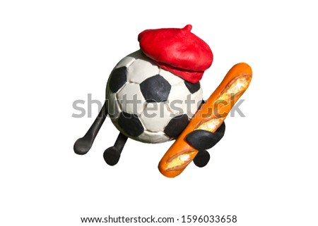 Plasticine cartoon soccer ball in traditional red beret with baguette in his hand isolated on white background