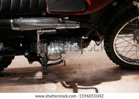 Closeup of chrome motorcycle muffler. #1596055042