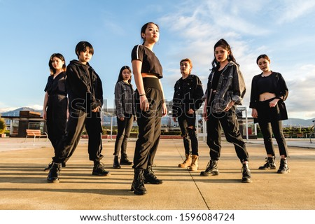 Young Asian team posing looking at camera. Chinese teenage friends Royalty-Free Stock Photo #1596084724