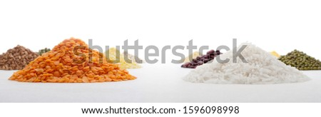 Heaps of red lentils and long rice on a background of thematically similar heaps #1596098998