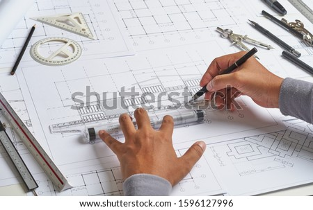 Architect engineer contractor design working drawing sketch plan blueprint and making architectural construction house building.                              #1596127996