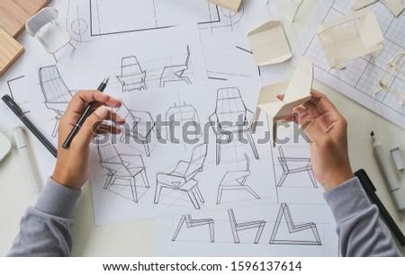 Designer sketching drawing design development product plan draft chair armchair Wingback Interior furniture prototype manufacturing production. designer studio concept .                            #1596137614