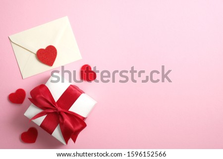 Romantic love letter and gift box with red ribbon on pink background with Valentines hearts. Flat lay, top view, copy space. Happy Valentine's Day concept #1596152566