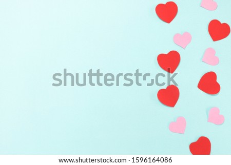 Red and pink heart switch on blue background. #1596164086