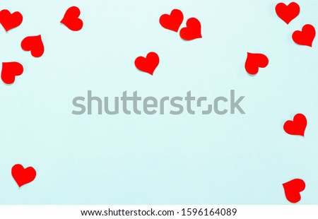 Red paper hearts isolated on blue background. #1596164089