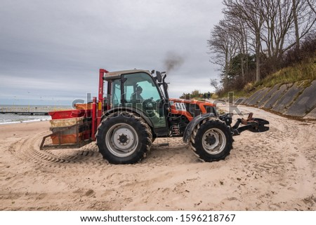Jaroslawiec, Poland - October 31, 2016: A tractor on the beach used by fishermen after half a fish #1596218767