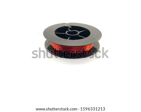Fishing line isolated on a white background. Coil of red fishing line. Fishing line for fishing rod.  #1596331213