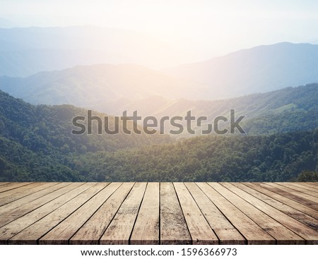 Wood desk or wood floor for product display with mountain background