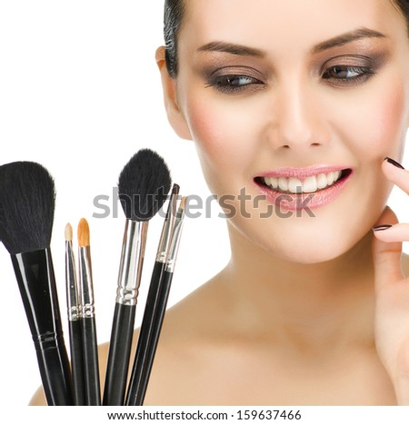 make up , beauty woman face, brushes, portrait of attractive young caucasian girl brunette , toothy smile; happy; close up , isolated on white , studio shot , looking at camera, eyes, lips #159637466