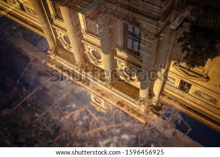 Reflections in puddles or glass of street and public buildings #1596456925