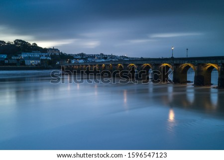 Bideford`s ancient Long Bridge in North Devon built in the 13th century. Royalty-Free Stock Photo #1596547123