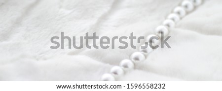 Jewelry branding, elegance and sale concept - Winter holiday jewellery fashion, pearl necklace on fur background, glamour style present and chic gift for luxury jewelery brand shopping, banner design #1596558232