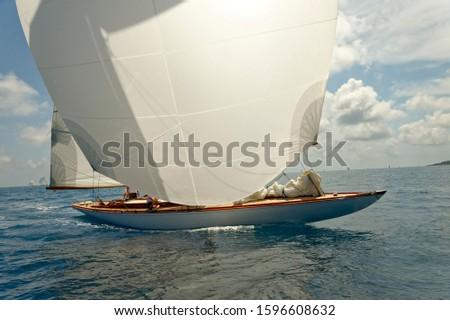 Sailboat under white sails at the regatta. Sailing yacht race #1596608632