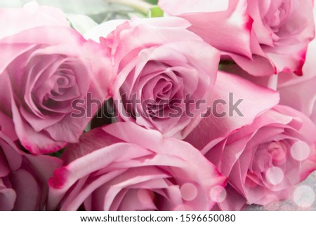 Flower arrangement - a bouquet of pink roses on table close up