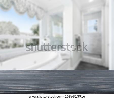 Wood tabletop on blur bathroom background, design key visual layout #1596813916