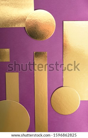 Top view of golden colored circles, rectangles on the purple surface.Empty space for design, products or text #1596862825