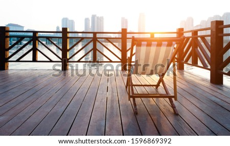 Deck chair on deck by the sea. #1596869392