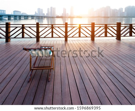 Deck chair on deck by the sea. #1596869395
