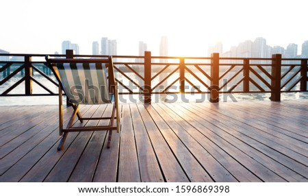 Deck chair on deck by the sea. #1596869398