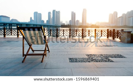 Deck chair on deck by the sea. #1596869401