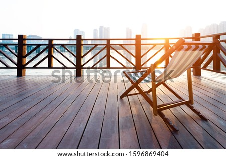 Deck chair on deck by the sea. #1596869404