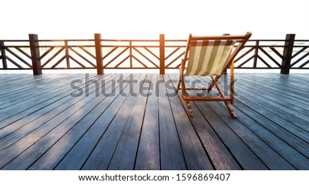 Deck chair on deck by the sea. #1596869407