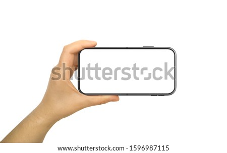 Hand Holding Horizontal Mobile Phone With Blank and White Screen Royalty-Free Stock Photo #1596987115